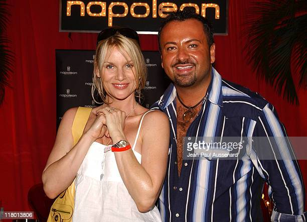 Nicollette Sheridan and Napoleon Perdis during Silver Spoon PreGolden Globe Hollywood Buffet Day 2 at Private Residence in Los Angeles California...