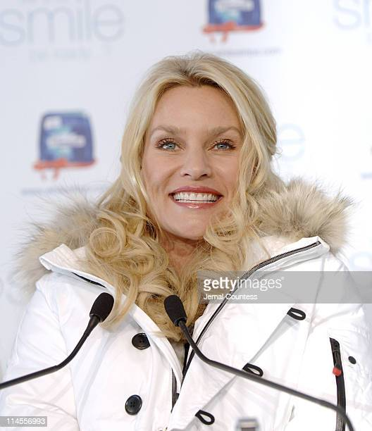 Nicollette Sheridan flashes her pearly whites for a good cause at the Crest Whitestrips Premium holiday photo booth at New York City's Wollman Rink ...
