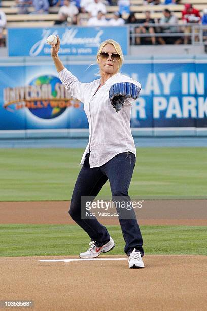 Nicollette Sheridan throws out the ceremonial first pitch at a game between the Cincinnati Reds and the Los Angeles Dodgers at Dodger Stadium August...