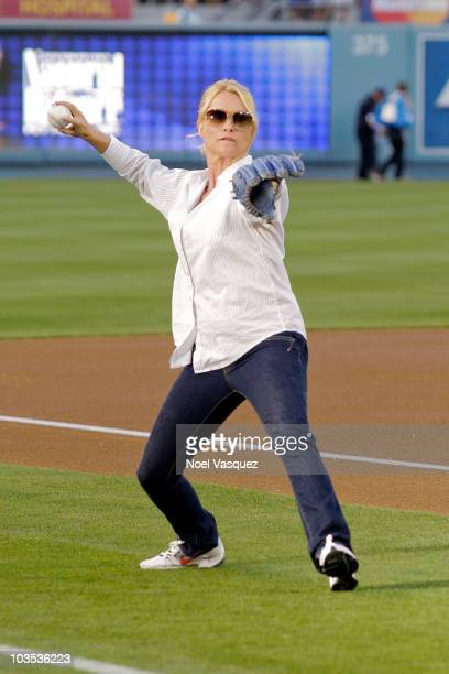 Nicollette Sheridan throws out the ceremonial first pitch at a game between the Cincinnati Reds and the Los Angeles Dodgers at Dodger Stadium on...