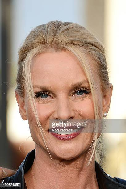 Nicollette Sheridan visits 'Extra' at Universal Studios Hollywood on November 19 2013 in Los Angeles California