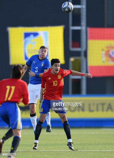 Nicolo Armini of Italy and Nabil Touazi of Spain compete for the ball during the U17 International Friendly match between Italy and Spain at Juventus...