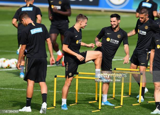 Nicolo Barella and Matteo Politano of FC Internazionale in action during FC Internazionale training session at Appiano Gentile on September 11 2019...
