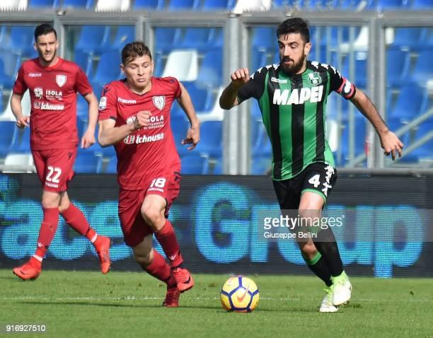 Nicolo' Barella of Cagliari Calcio and Francesco Magnanelli of US Sassuolo in action during the serie A match between US Sassuolo and Cagliari Calcio...