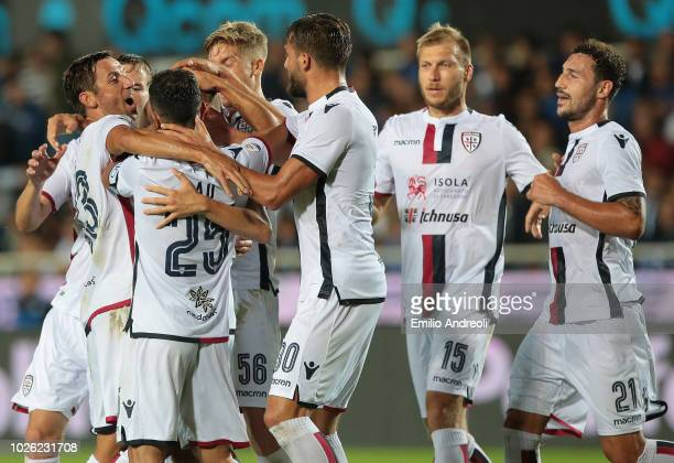 Nicolo Barella of Cagliari Calcio celebrates with his teammates after scoring the opening goal during the serie A match between Atalanta BC and...