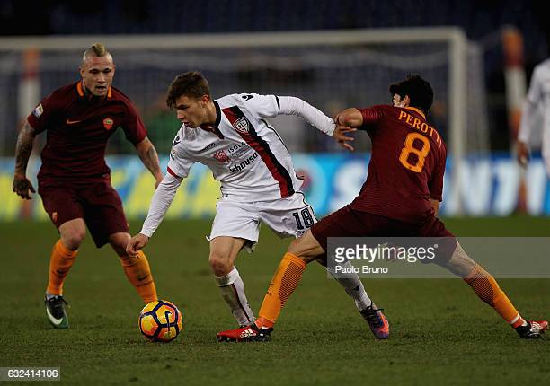 Nicolo' Barella of Cagliari Calcio competes for the ball with Diego Perotti of AS Roma during the Serie A match between AS Roma and Cagliari Calcio...