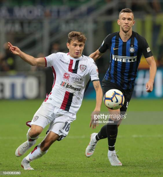 Nicolo Barella of Cagliari Calcio is challenged by Ivan Perisic of FC Internazionale during the Serie A match between FC Internazionale and Cagliari...