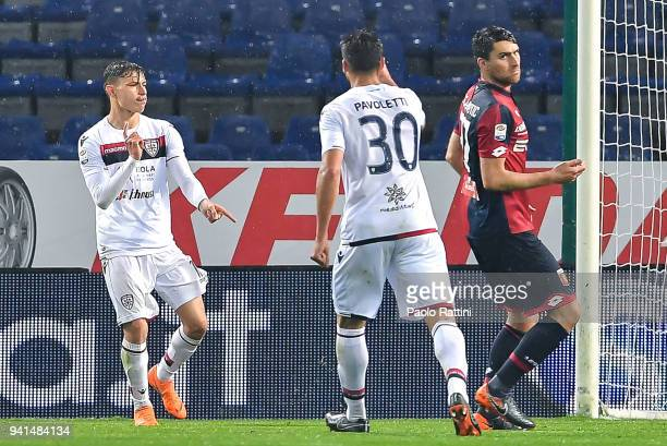 Nicolo Barella of Cagliari celebrates with teammate Leonardo Pavoletti after scoring a goal on a penalty kickl during the serie A match betweenGenoa...