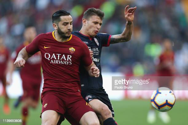 Nicolo' Barella of Cagliari competes for the ball with Kostas Manolas of AS Roma during the Serie A match between AS Roma and Cagliari at Stadio...