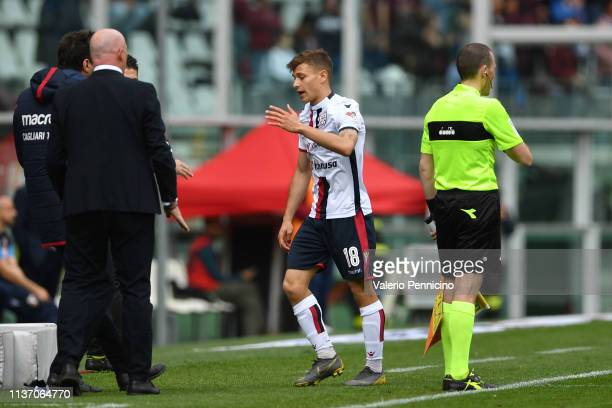 Nicolo Barella of Cagliari walks off after receiving the red card from the referee during the Serie A match between Torino FC and Cagliari at Stadio...