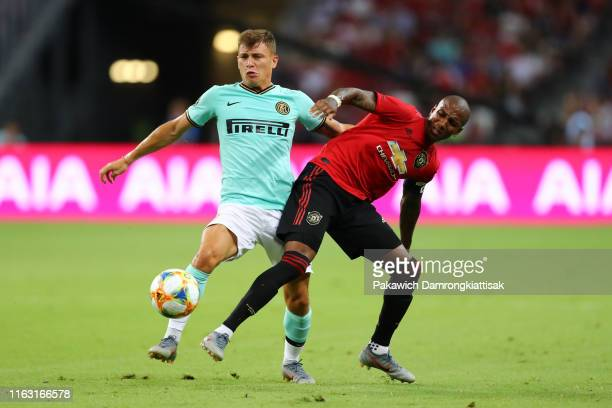Nicolo Barella of FC Internazionale and Ashley Young of Manchester United compete for the ball during the 2019 International Champions Cup match...