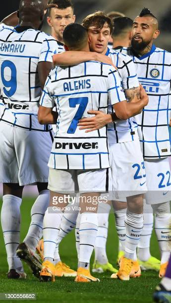 Nicolo Barella of FC Internazionale celebrate with Alexis Sanchez after scoring the opening goal during the Serie A match between ACF Fiorentina and...