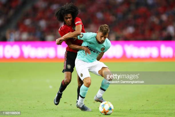 Nicolo Barella of FC Internazionale controls the ball under pressure of Tahith Chong of Manchester United during the 2019 International Champions Cup...