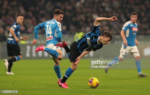 Nicolo Barella of FC Internazionale is challenged by Dries Mertens of SSC Napoli during the Coppa Italia Semi Final match between FC Internazionale...
