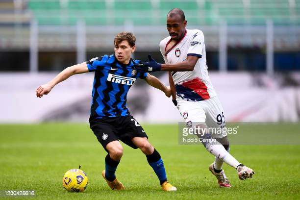 Nicolo Barella of FC Internazionale is challenged by Eduardo Henrique of FC Crotone during the Serie A football match between FC Internazionale and...