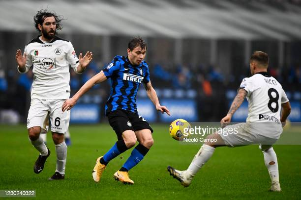 Nicolo Barella of FC Internazionale is challenged by Luca Mora and Matteo Ricci of Spezia Calcio during the Serie A football match between FC...