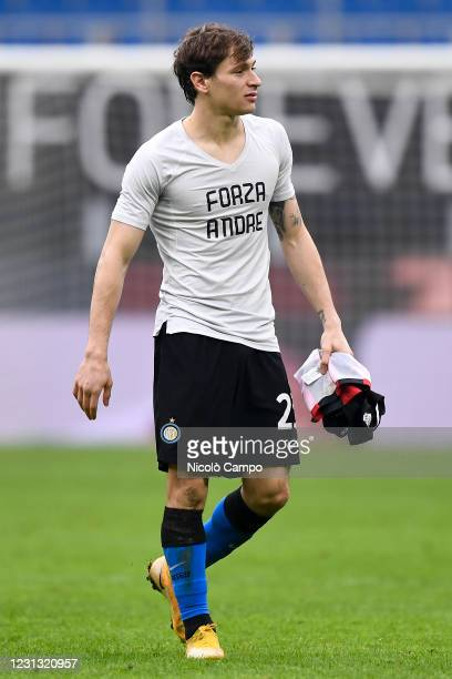 Nicolo Barella of FC Internazionale wearing a t-shirt reading 'Forza Andre' for his former teammate Andrea Cossu celebrates at the end of the Serie A...