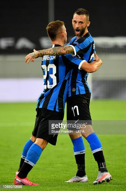 Nicolo Barella of Inter Milan celebrates after scoring his sides first goal with teammate Marcelo Brozovic during the UEFA Europa League Quarter...