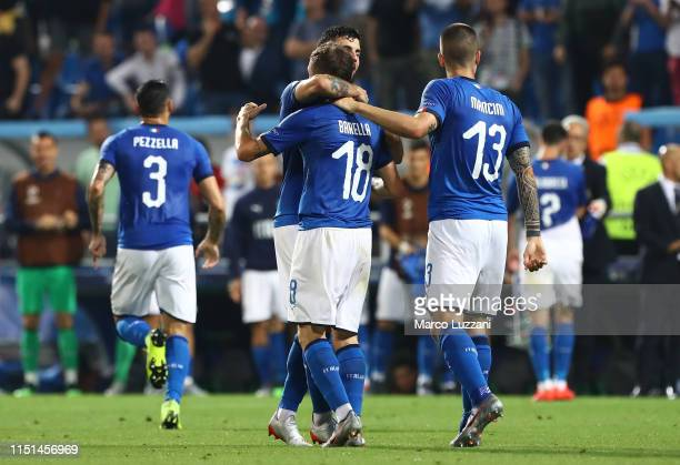 Nicolo Barella of Italy celebrates with his teammates after scoring the opening goal during the 2019 UEFA U21 Group A match between Belgium and Italy...