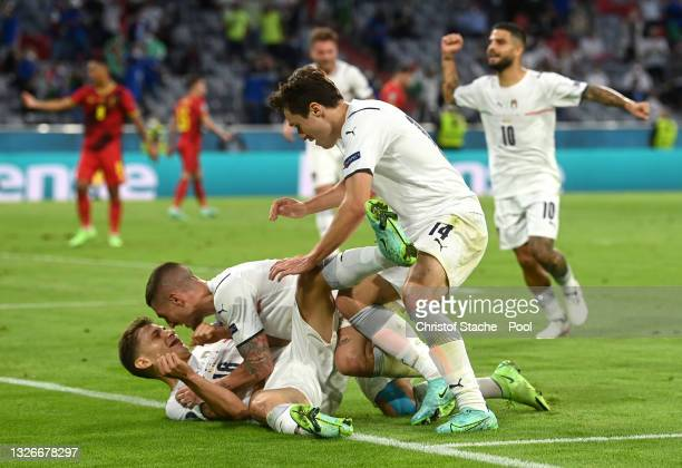 Nicolo Barella of Italy celebrates with Marco Verratti and Federico Chiesa after scoring their side's first goal during the UEFA Euro 2020...