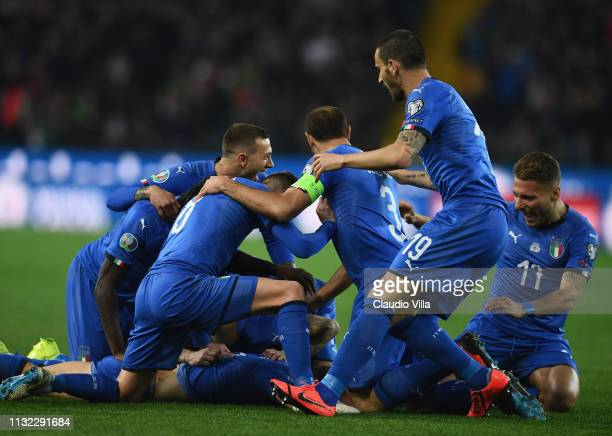 Nicolo Barella of Italy celebrates with teammates after scoring the opening goal during the 2020 UEFA European Championships group J qualifying match...