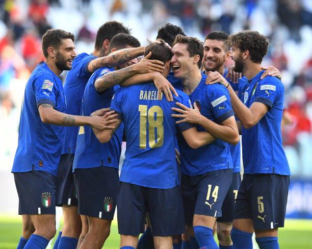 Nicolo Barella of Italy celebrates with team-mates after scoring the opening goal during the UEFA Nations League 2021 Third Place Match between Italy...