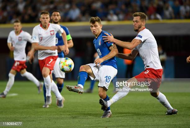 Nicolo Barella of Italy clashes with Pawel Bochniewicz of Poland during the 2019 UEFA U21 Group A match between Italy and Poland at Renato Dall'Ara...