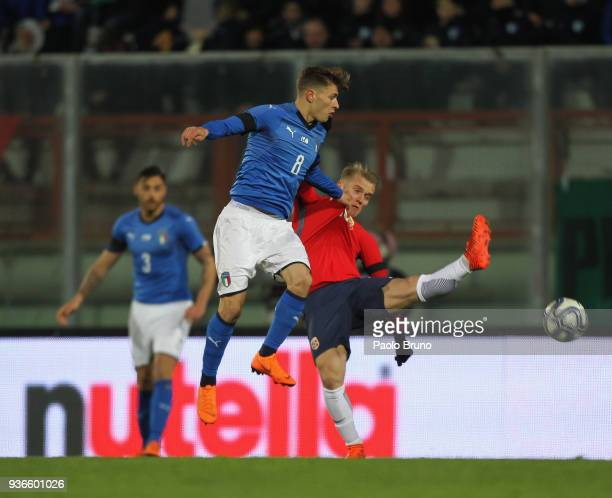 Nicolo' Barella of Italy competes for the ball with Ivan Tarik Fjelistad Nasberg of Norway during the international friendly match between Italy U21...