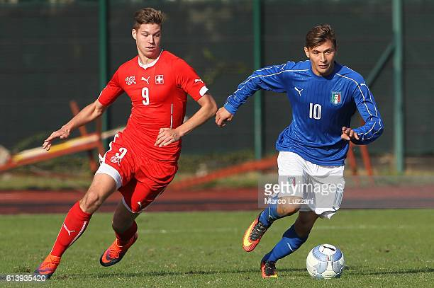 Nicolo Barella of Italy is challenged by Cedric Itten of Switzerland during the Four Nations tournament match between Italy U20 and Switzerland U20...