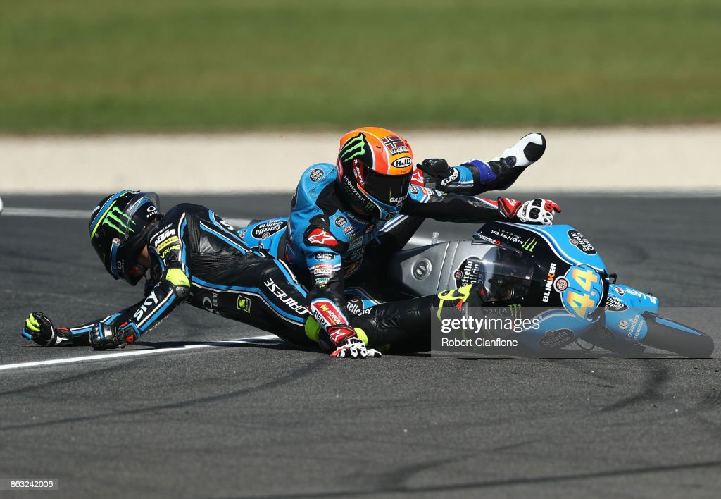 Nicolo Bulega of Italy and riding the #8 Sky Racing Team VR46 KTM crashes into Aron Canet of Spain and rider of the #44 Estrella Galicia 0,0 Honda during Moto3 free practice for the 2017 MotoGP of Australia at Phillip Island Grand Prix Circuit on October 20, 2017 in Phillip Island, Australia.