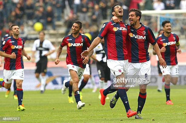 Nicolo Cherubin of Bologna FC celebrates with his teammate Gyorgy Garics after scoring the opening goal during the Serie A match between Bologna FC...