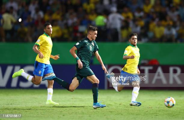 Nicolo Cudrig of Italy looks to break past Yan Couto of Brazil during the FIFA U17 World Cup Quarter Final match between Italy and Brazil at the...