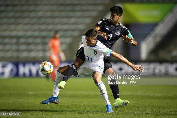 Nicolo Cudrig of Italy struggles for the ball with Alejandro Gomez of Mexico during the FIFA U17 Men's World Cup Brazil 2019 group F match between...