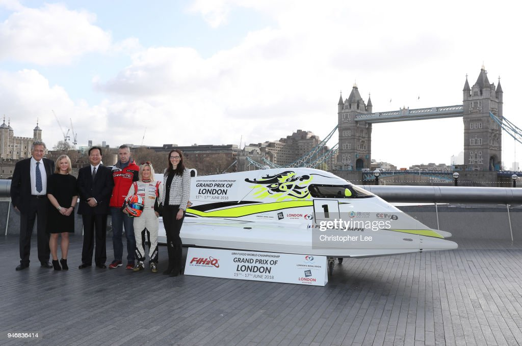 Nicolo di San Germano, President of H2O Racing, Joanna Jones, Commerical Director at London Tech Week, ::lh::Mr. Li Haojie, Chairman of Tian Rong Sports, Philippe Chiappe, Professional powerboat driver, Marit Stromoy, Professional powerboat driver and Ms. Jules Chappell OBE, Managing Director, Business at London & Partners pose for a photo with the CTIC F1 Shenzhen China boat infront of Tower Brdige during the UIM F1H2O Grand Prix Of London Launch in London on April 16, 2018 in London, England.