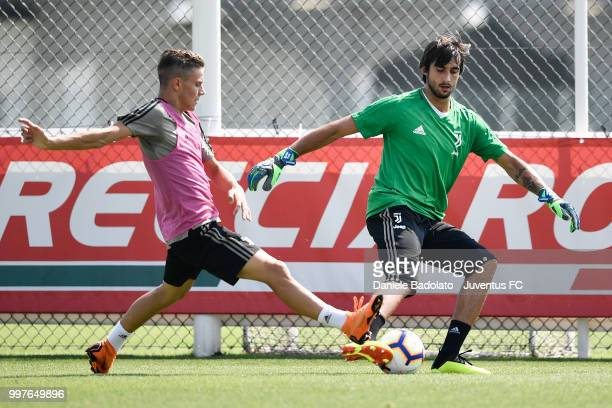Nicolo Fagioli and Mattia Perin during a Juventus training session at Juventus Training Center on July 13 2018 in Turin Italy