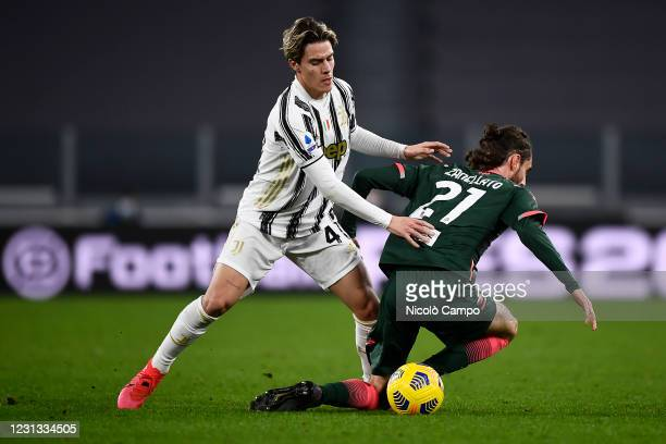 Nicolo Fagioli of Juventus FC competes for the ball with Niccolo Zanellato of FC Crotone during the Serie A football match between Juventus FC and FC...