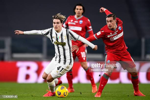 Nicolo Fagioli of Juventus FC is challenged by Salvatore Esposito of SPAL during the Coppa Italia football match between Juventus FC and SPAL....
