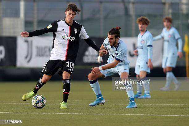 Nicolo Fagioli of Juventus Turin U19 and Alberto Salido of Atletico Madrid U19 battle for the ball during the UEFA Youth League match between...