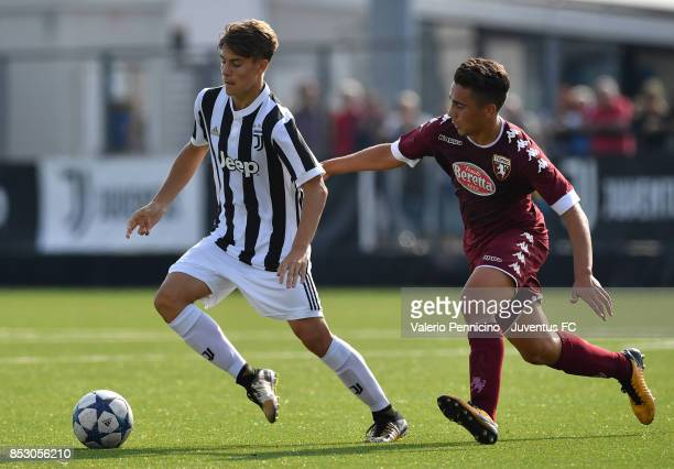 Nicolo Fagioli of Juventus U17 is challenged by Stefano Cuoco of Torino FC U17 during the match between Juventus U17 v Torino FC U17 on September 24...