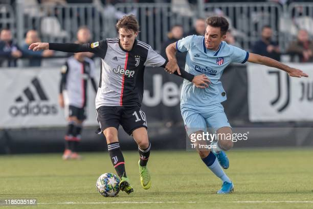 Nicolo Fagioli of Juventus U19 and Oscar Castro of Atletico Madrid battle for the ball during the UEFA Youth League match between Juventus U19 and...