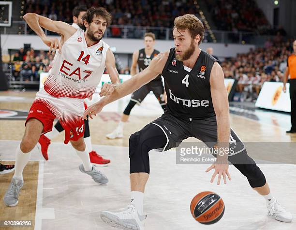 Nicolo Melli #4 of Brose Bamberg competes with Davide Pascolo #14 of EA7 Emporio Armani Milan in action during the 2016/2017 Turkish Airlines...
