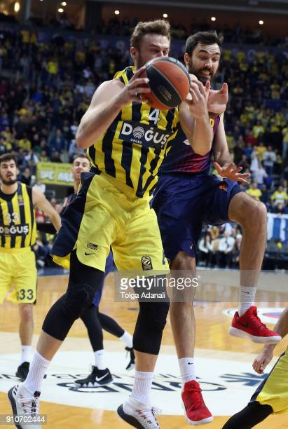 Nicolo Melli #4 of Fenerbahce Dogus in action with Ante Tomic #44 of FC Barcelona Lassa during the 2017/2018 Turkish Airlines EuroLeague Regular...