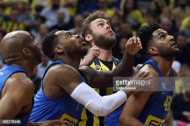 Nicolo Melli #4 of Fenerbahce Dogus in action with Jonah Bolden #43 and Deandre Kane #7 of Maccabi Fox Tel Aviv during the 2017/2018 Turkish Airlines...