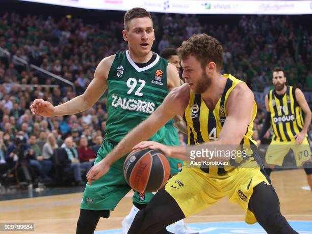Nicolo Melli #4 of Fenerbahce Dogus Istanbul competes with Edgaras Ulanovas #92 of Zalgiris Kaunas in action during the 2017/2018 Turkish Airlines...