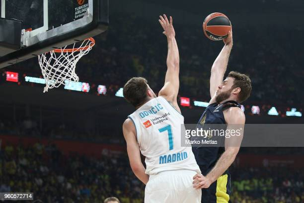 Nicolo Melli #4 of Fenerbahce Dogus Istanbul competes with Luka Doncic #7 of Real Madrid during the 2018 Turkish Airlines EuroLeague F4 Championship...