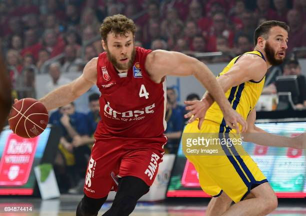 Nicolo Melli of Bamberg challenges Philipp Schwethelm of Oldenburg during game 3 of the 2017 BBL Finals at Brose Arena on June 11 2017 in Bamberg...