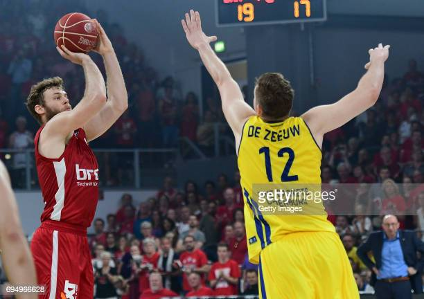 Nicolo Melli of Bamberg shoots against Maxime De Zeeuw of Oldenburg during game 3 of the 2017 BBL Finals at Brose Arena on June 11 2017 in Bamberg...