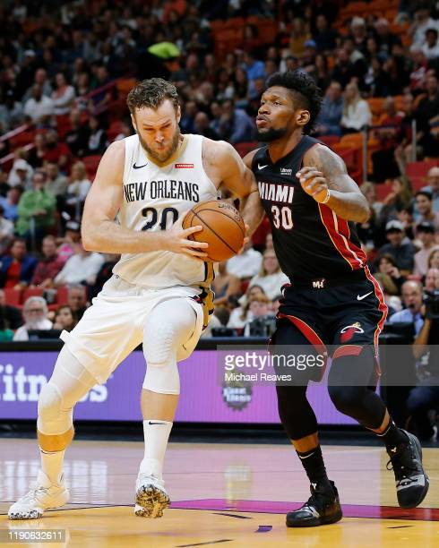 Nicolo Melli of the New Orleans Pelicans drives to the basket against Chris Silva of the Miami Heat during the first half at American Airlines Arena...