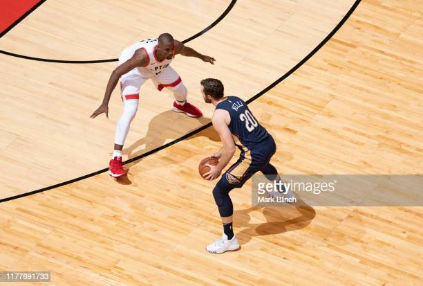 Nicolo Melli of the New Orleans Pelicans handles the ball against Serge Ibaka of the Toronto Raptors on October 22 2019 at the Scotiabank Arena in...