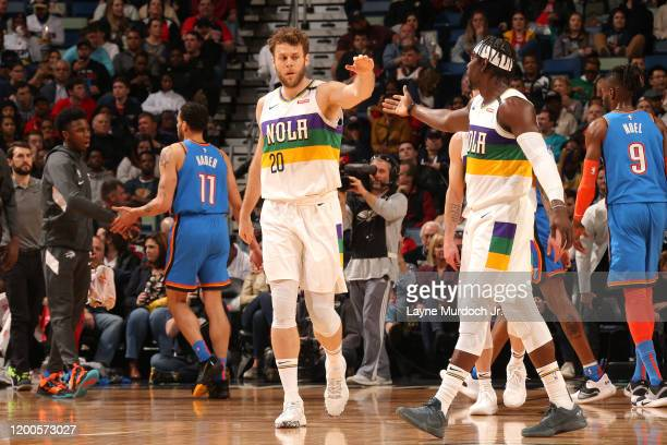 Nicolo Melli of the New Orleans Pelicans highfives Jrue Holiday of the New Orleans Pelicans against the Oklahoma City Thunder on February 13 2020 at...